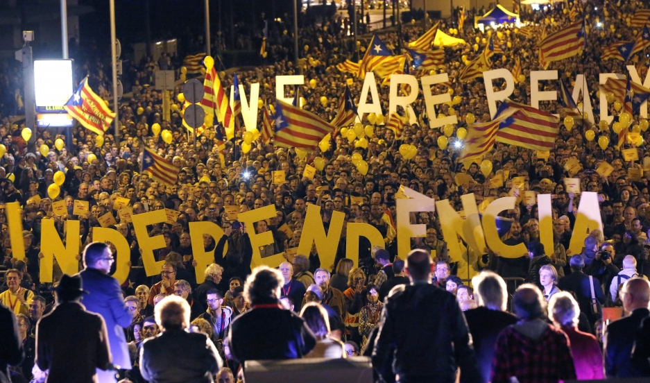 "Pro-independence Catalonians hold up giant letters reading ""We are ready, Independence"" during the final meeting before a ceremonial referendum in Barcelona on November 7, 2014."