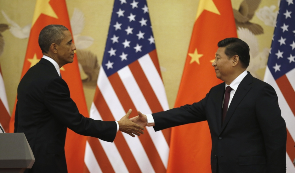 U.S. President Barack Obama and Chinese President Xi Jinping shake hands at the end of their news conference in the Great Hall of the People in Beijing on November 12, 2014.