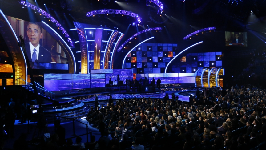 President Barack Obama is shown on a large screen as he delivers his immigration speech from the White House before the start of the 15th Annual Latin Grammy Awards in Las Vegas on November 20, 2014.