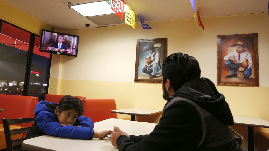 Esteban Cabanas, 30, an undocumented immigrant from Mexico, watches President Barack Obama's White House immigration speech on Thursday,