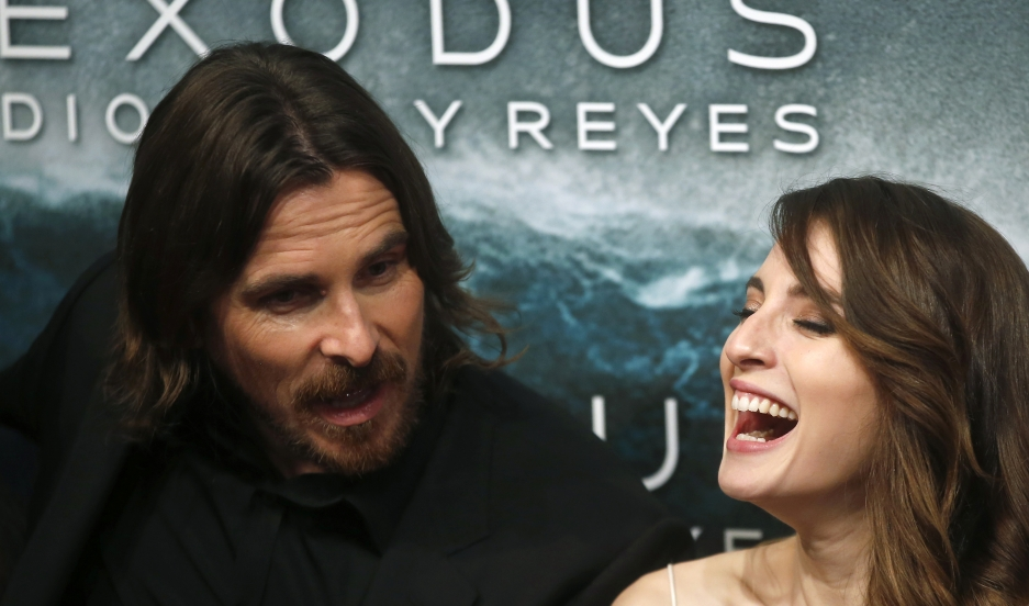 "Cast members Christian Bale and Maria Valverde pose for photographs as they arrive for the film world premiere of ""Exodus: Gods and Kings"" in Madrid, Spain."