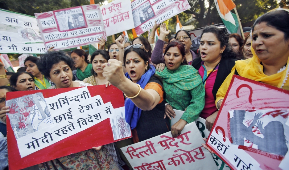 "Members of the All India Mahila Congress, the women's wing of the Congress {arty, carry placards that read, ""The country is covered in shame...""  The women were protesting the rape of a female passenger by an Uber taxi driver in New Delhi."
