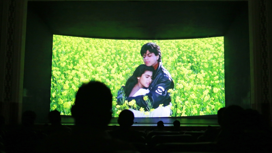 Inside the Mumbai theater, moviegoers look at the screen.