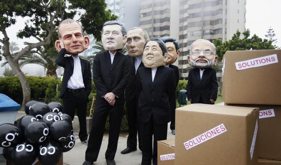 Activists wearing masks depicting Australia's Prime Minister Tony Abbott, Canada's Prime Minister Stephen Harper, Russia's President Vladimir Putin, Japan's Prime Minister Shinzo Abe, China's President Xi Jinping and India's Prime Minister Narendra Modi d