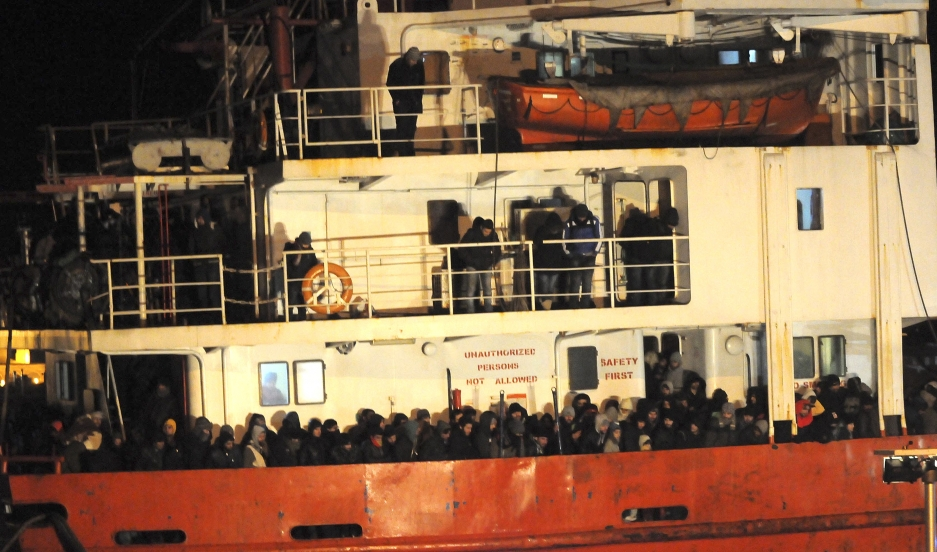 A ship called Blue Sky M docking in southern Italy on New Year's Eve 2014 after being rescued. Locals interrupted their celebrations to help the hundreds of freezing refugees on board.