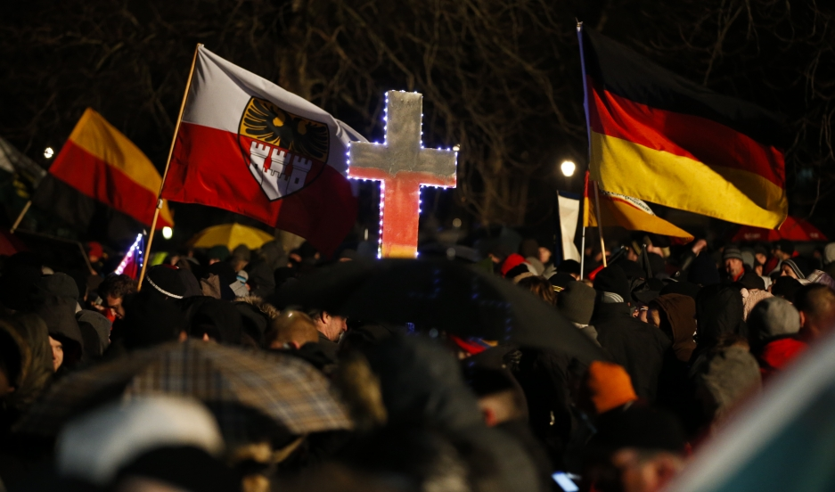 """Participants take part in a demonstration called by anti-immigration group PEGIDA, a German abbreviation for """"Patriotic Europeans against the Islamization of the West"""", in Dresden January 5, 2015."""