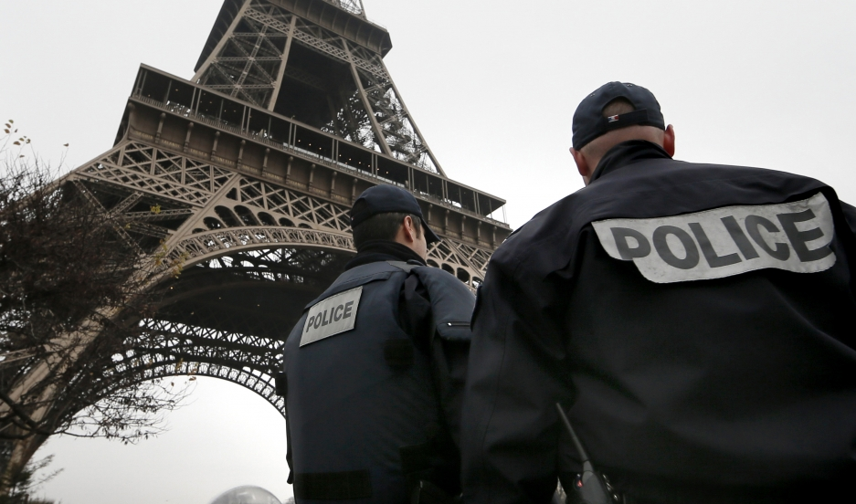 "French police patrol near the Eiffel Tower in Paris as part of the highest level of ""Vigipirate"" security plan after a shooting at the Paris offices of Charlie Hebdo on January 7, 2015."