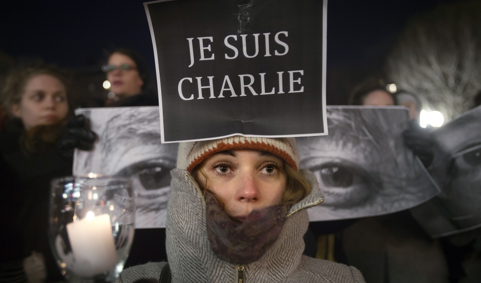 Armandine Marbach takes part in a demonstration on January 7, 2014, supporting the French publication Charlie Hebdo