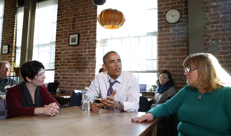 President Barack Obama talks about legislation to offer paid sick leave for Americans while at Charmington's Cafe in Baltimore, Maryland, on January 15, 2015.