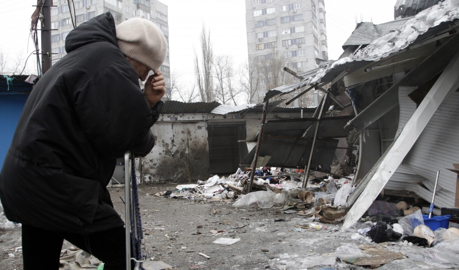 A woman reacts as she stands at a market that, according to locals, was recently damaged by shelling in Donetsk.