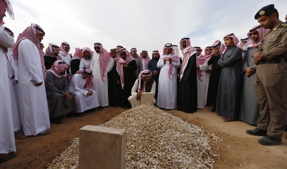 Mourners gather around the grave of Saudi King Abdullah following his burial in Riyadh on Friday.