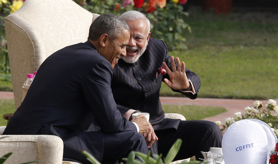 President Barack Obama and India's prime minister, Narendra Modi, talk as they have coffee and tea together in the gardens of Hyderabad House in New Delhi on January 25, 2015. Obama is visiting India for three days to attend Republic Day celebrations and