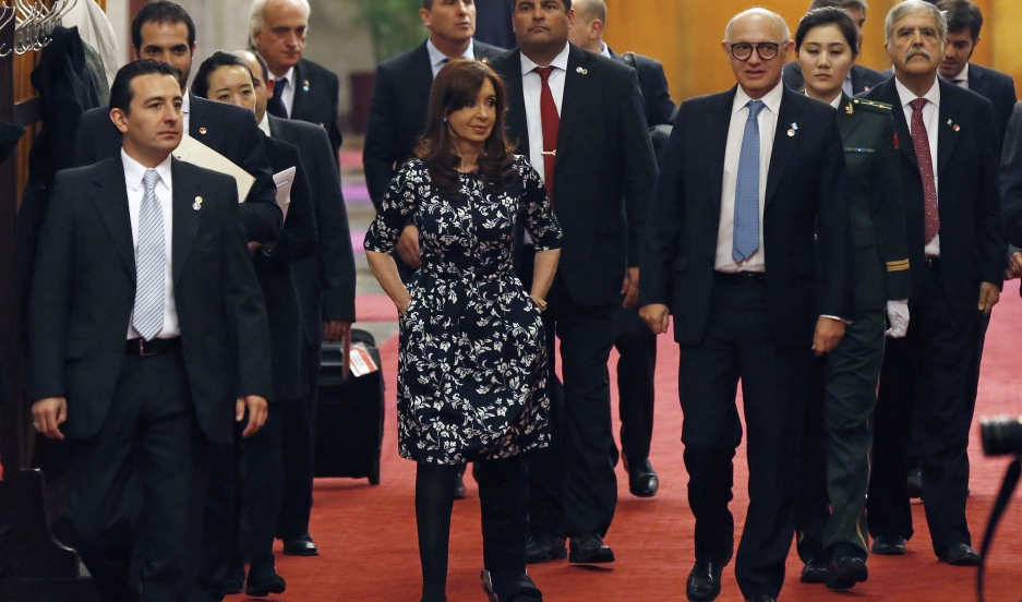 Argentina's President Cristina Fernandez de Kirchner  walks on the carpet before a meeting at the Great Hall of the People in Beijing February 5, 2015.