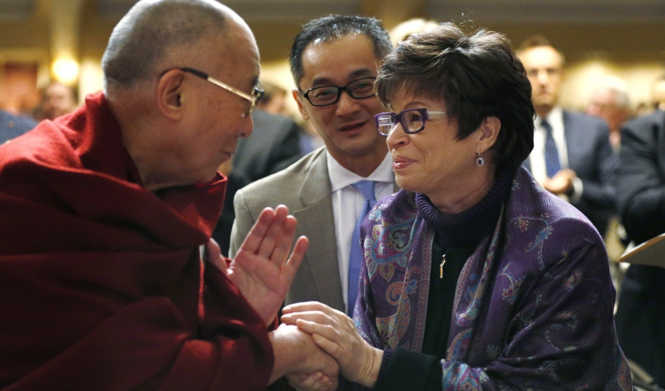 Here is the Dalai Lama not meeting with President Obama on February 5, 2015, in Washington. Instead, he is shaking hands with Valerie Jarrett, a senior advisor to the US president.