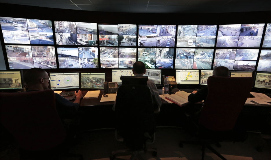 Municipal police officers watch screens in the video surveillance control room of the municipal police supervision centre in Nice February 9, 2015.