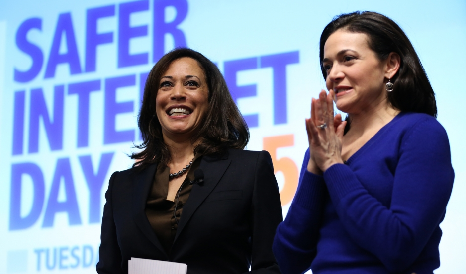 California Attorney General Kamala Harris, at left, shares the stage with Facebook COO Sheryl Sandberg following Harris' address at the Facebook headquarters in Menlo Park, California on February 10, 2015.