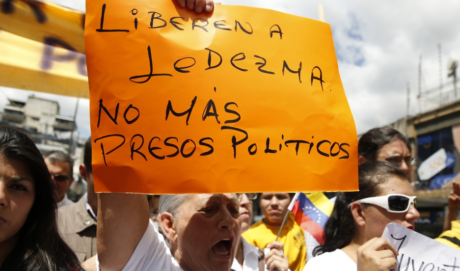 """Supporters of Caracas mayor Antonio Ledezma gather to protest his arrest by President Nicolas Maduro. The banner reads: """"Freedom to Ledezma. No more political prisoners""""."""