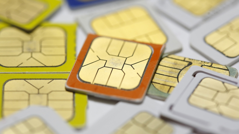 SIM cards lie on a table in this photo illustration taken in Sarajevo February 24, 2015.