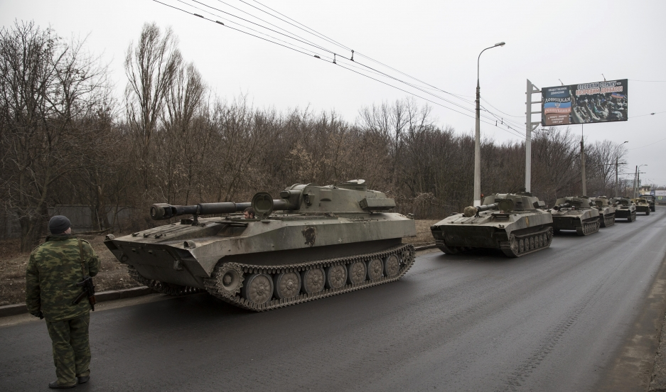 A convoy of self-propelled artillery guns on the move near Donetsk on February 26, 2015. Heavy weapons like these are reported to be concentrating near Mariupol.