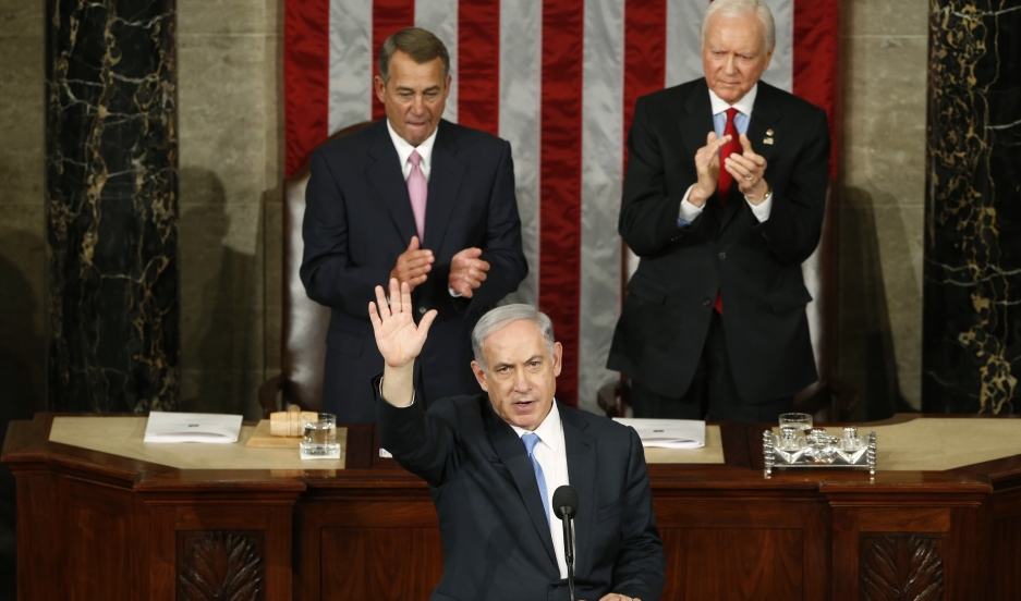 Israeli Prime Minister Benjamin Netanyahu speaks to a joint meeting of Congress on March 3, 2015. Speaker of the House John Boehner (R-Ohio) and President pro tempore of the Senate Orrin Hatch (R-Utah) applaud behind Netanyahu.