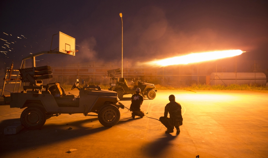 Shiite fighters fire a rocket during clashes with ISIS militants in Iraq's Salahuddin province on March 1, 2015. Thousands of Iraqi soldiers and Shiite militiamen sought to seal off ISIS in Tikrit and nearby towns.