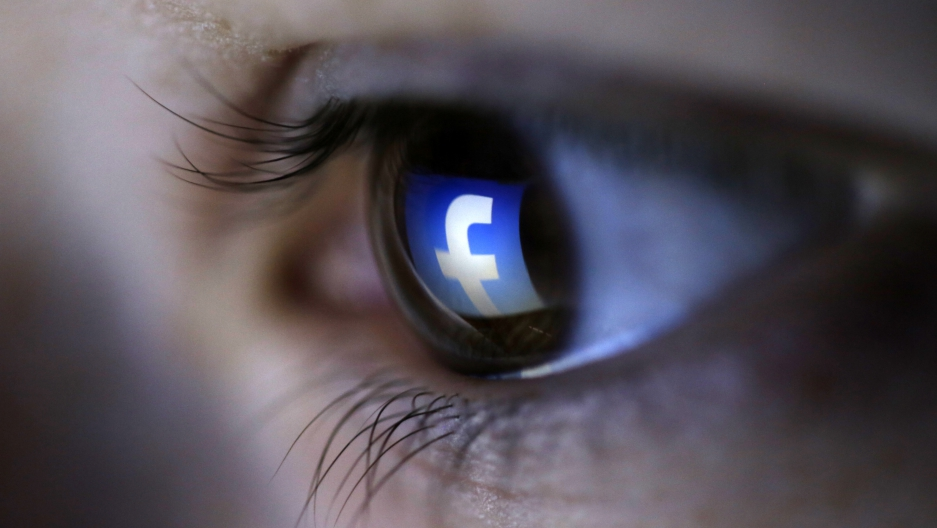 A picture illustration shows a Facebook logo reflected in a person's eye, in Zenica, March 13, 2015.