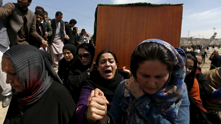 Afghan women's rights activists carry the coffin of Farkhunda, an Afghan woman who was beaten to death and set alight on fire on Thursday, during her burial ceremony in Kabul March 22, 2015