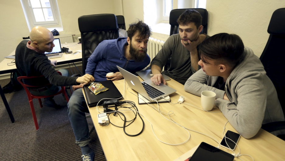 Journalists work in the independent, Russia-focused, media start-up Meduza office in Riga March 30, 2015.