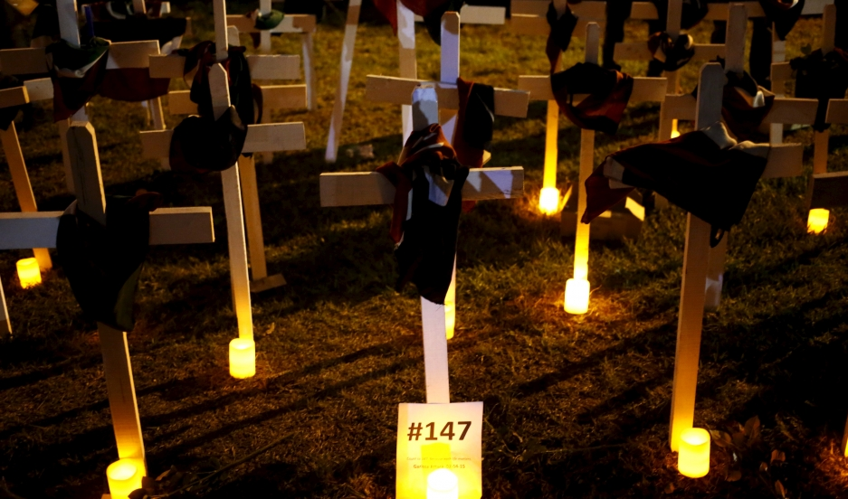 Wooden crosses are placed on the ground, symbolising the 147 people killed during an attack by gunmen at the Garissa University College.