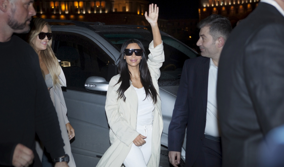 TV celebrity Kim Kardashian gestures on her way to a hotel shortly after arriving in Yerevan, Armenia, on April 8, 2015.
