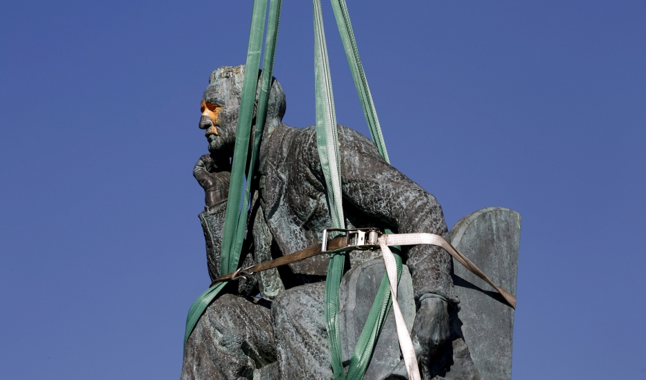 The statue of Cecil John Rhodes is bound by straps as it awaits removal from the University of Cape Town (UCT), April 9, 2015. UCT's Council voted on Wednesday to remove of the statue of the former Cape Colony governor, after protests by students