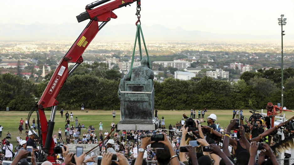 Students cheer as the statue of Cecil John Rhodes is removed from the University of Cape Town (UCT), April 9, 2015.