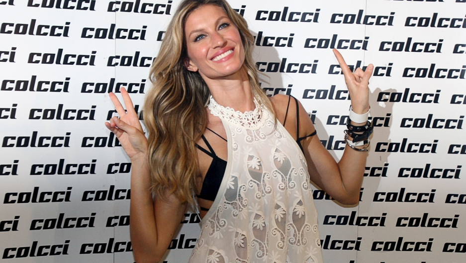 Brazilian top model Gisele Bundchen poses before the showcase of the Colcci Summer 2016 Ready To Wear collection during Sao Paulo Fashion Week.