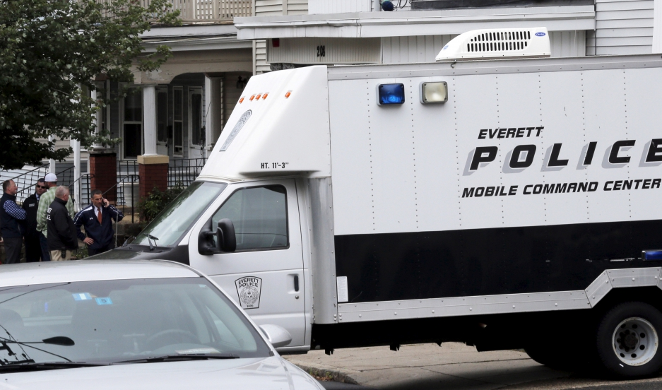 Law enforcement officials are gathered on a residential street in Everett, Massachusetts June 2, 2015 in connection to a man shot dead by law enforcement in Boston.