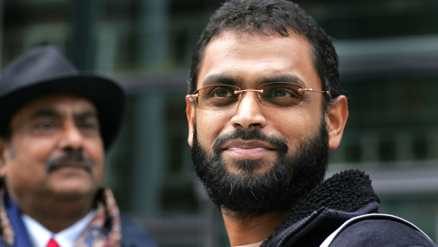 Freed Guantanamo Bay detainee Moazzam Begg stands outside the Home Office with his father, Azmat, after delivering a petition in London on March 14, 2005.