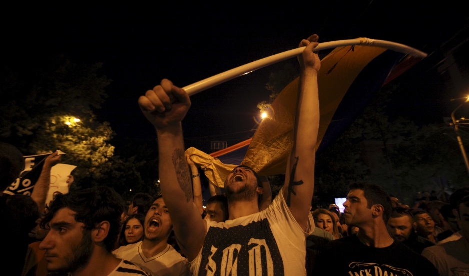 Thousands of Armenians staged a second day of protests on Tuesday in the capital Yerevan against a hike in electricity prices, defying police who used water cannon to try to disperse them.