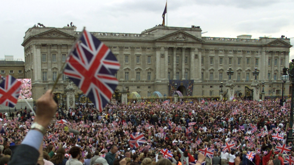 Thousands wave flags and sing 'Land Of Hope And Glory' outside Buckingham Palace in London during celebrations of Queen Elizabeth's 50th year on the throne, in 2002.