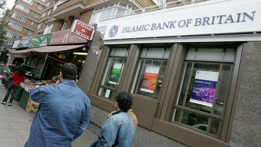 People walk past Islamic Bank of Britain's (IBB) first branch on Edgware Road in London.