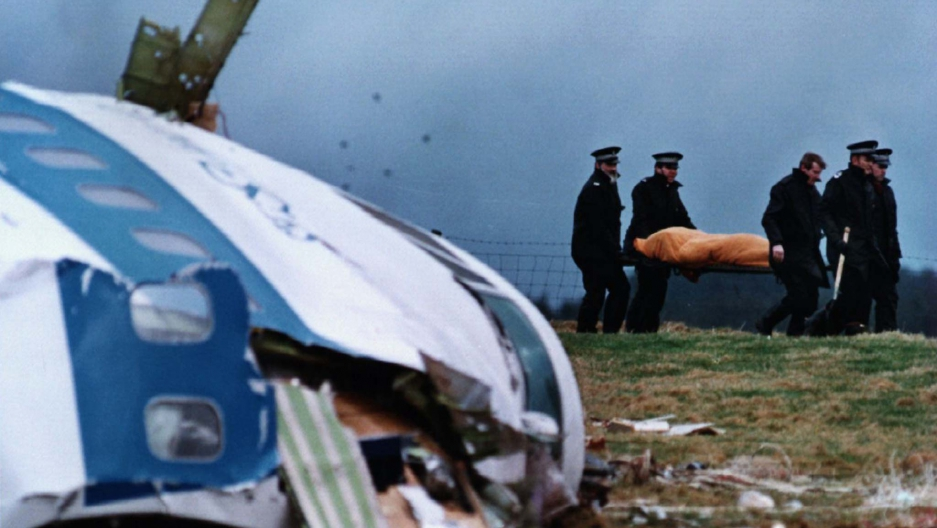 File photo from December 22, 1988, shows rescue personnel carrying a body away from the site of the crash in Lockerbie. A total of 270 people were killed when a bomb ripped apart Pan Am flight 103 over the Scottish town of Lockerbie in 1988.