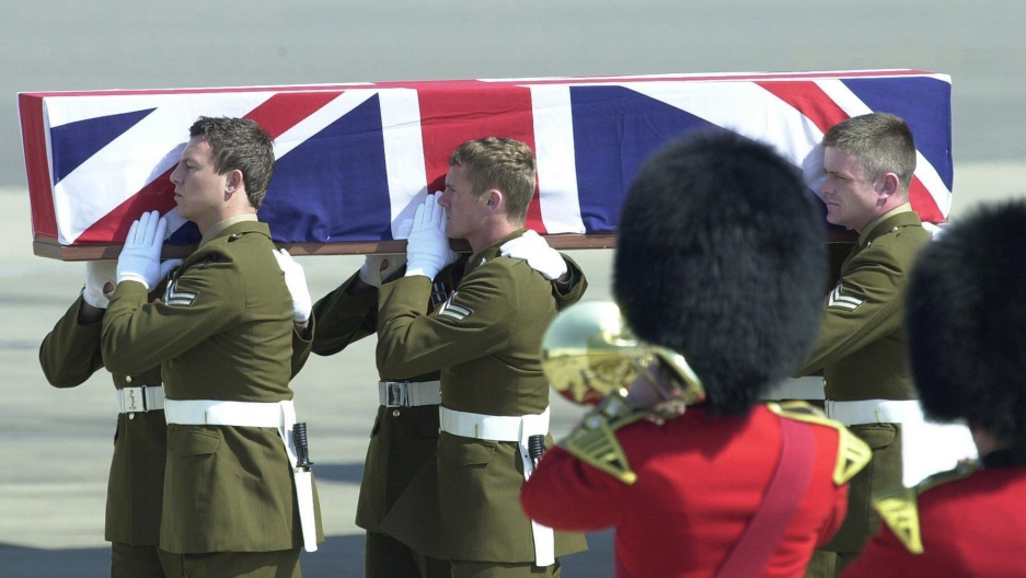 The coffin of Lance Corporal Shaun Brierley, of Britain's 212 Signal Squadron, who was killed on duty in the Gulf on March 30, is carried from a Boeing C-17 aircraft at RAF Brize Norton in Oxforshire, Britain, April 8, 2003.