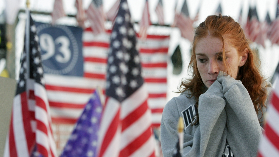 Courtney Ball, 19, of Sommerville, New Jersey, cries at the Flight 93 Temporary Memorial just outside Shanksville, Pennsylvania, September 11, 2005.