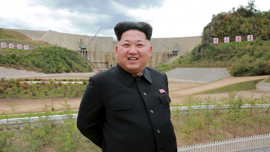 North Korean leader Kim Jong Un smiles during his visit to the construction site of the Paektusan Hero Youth Power Station near completion in this undated photo released by North Korea's Korean Central News Agency (KCNA) in Pyongyang September 14, 2015.