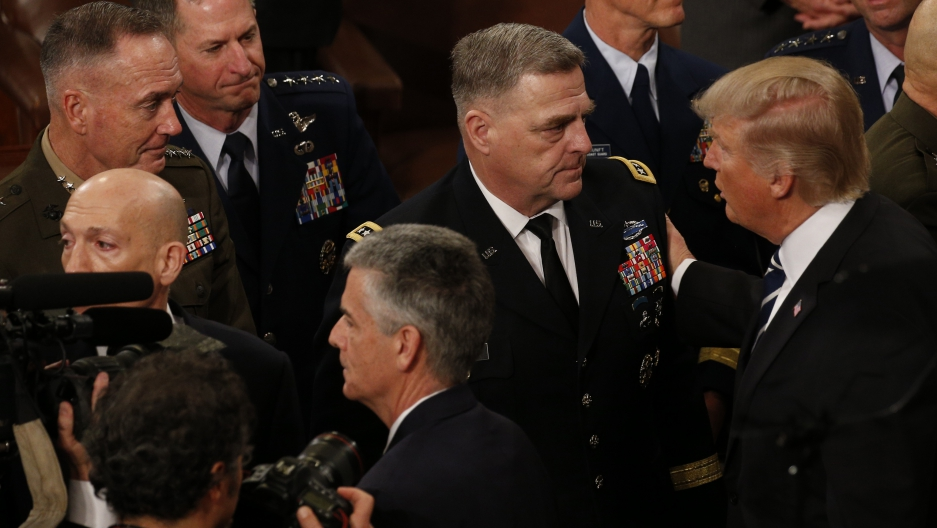 President Donald Trump talks to members of the US military's Joint Chiefs of Staff