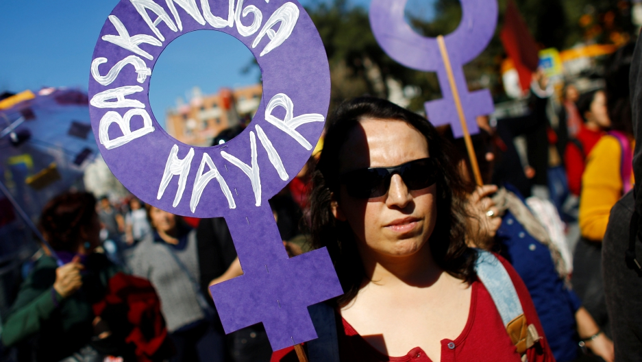 """A demonstrator holds a placard that reads: """"No to Presidency"""" during a Women's Day rally in Istanbul, Turkey, March 5, 2017."""