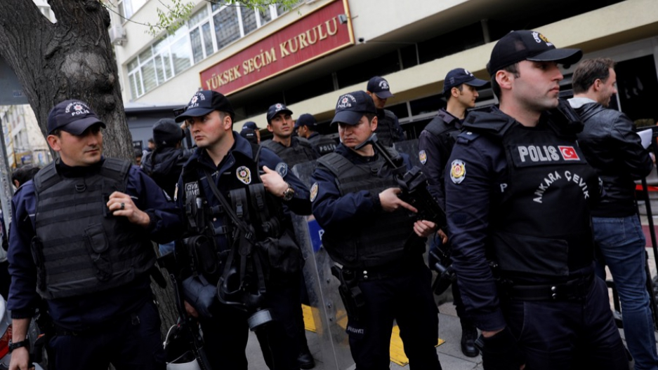 Riot police secure the entrance of the High Electoral Board in Ankara, Turkey