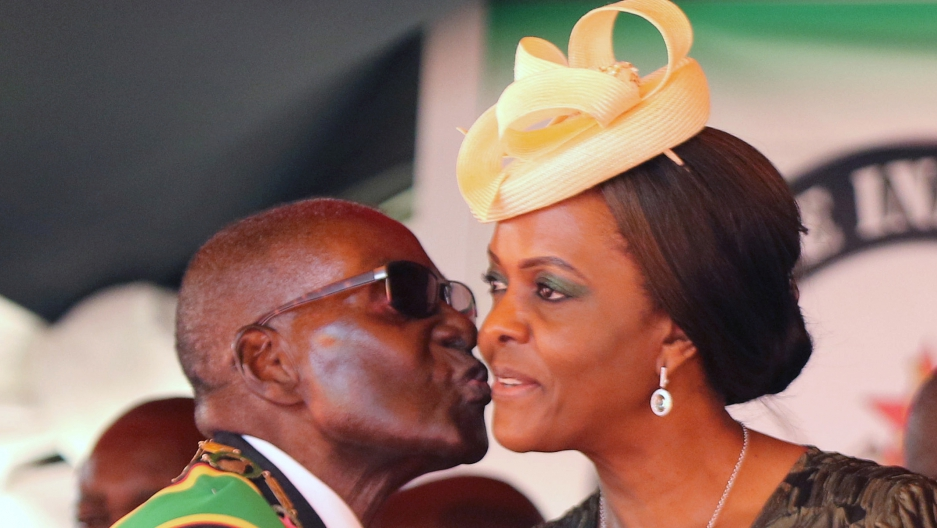 Robert Mugabe kisses his wife, Grace, at a rally to mark the country's 37th independence anniversary, in April
