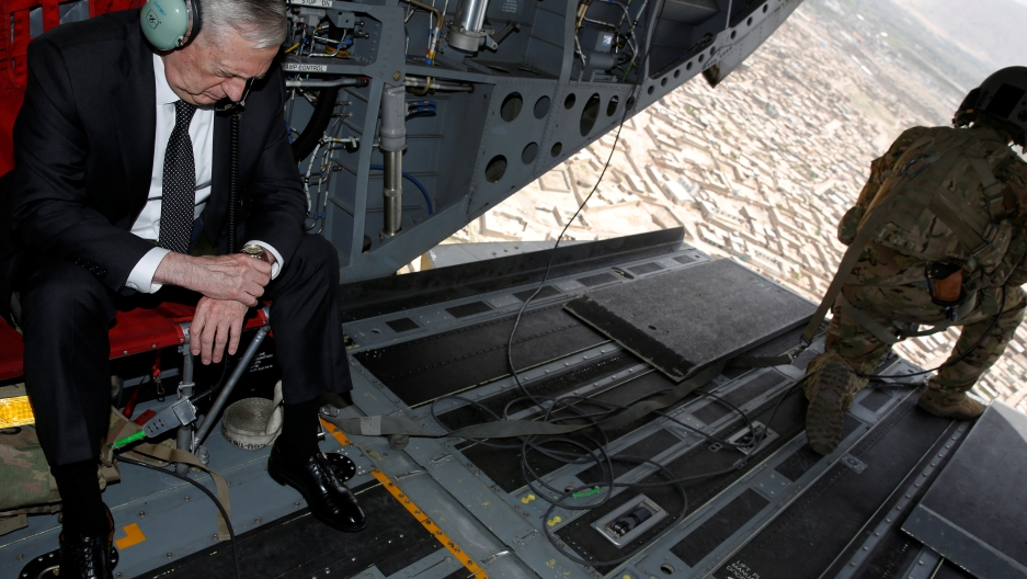 Defense Secretary, James Mattis, checks his watch as he arrives in Kabul, Afghanistan April 24th 2017