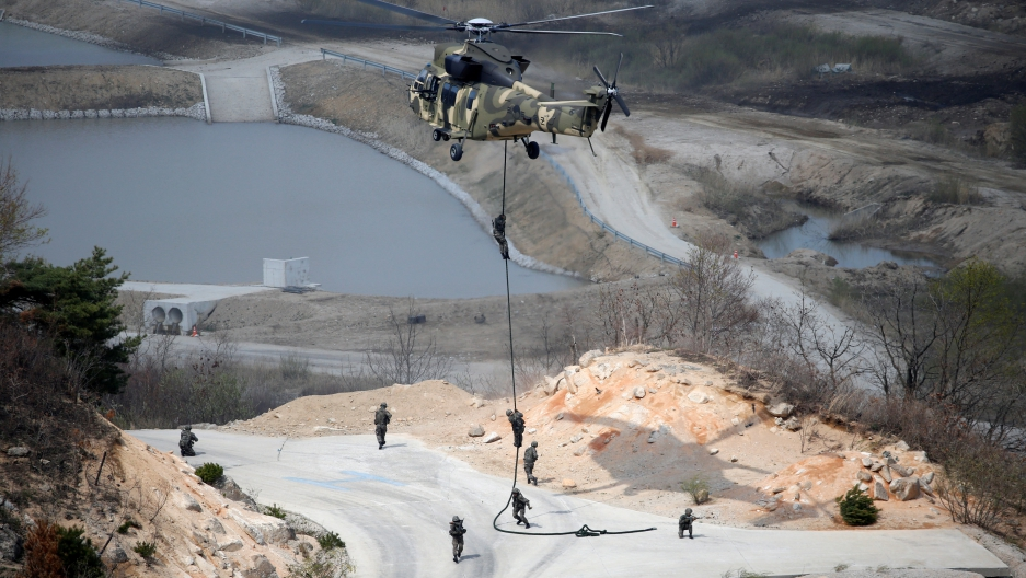 South Korean Army soldiers rappel down during a U.S.-South Korea joint live-fire military exercise, at a training field, near the demilitarized zone, separating the two Koreas in Pocheon, South Korea April 21, 2017.