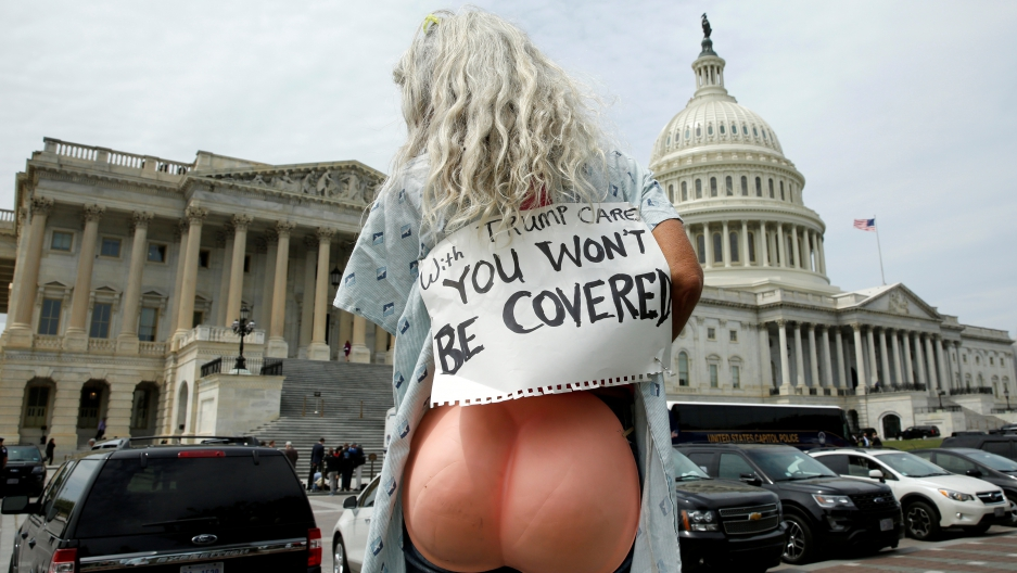 A protester rallies during the US House vote on the American Health Care Act, which repeals major parts of the 2000 Affordable Care Act know as Obamacare. Capitol Hill in Washington, US, May 4, 2017.