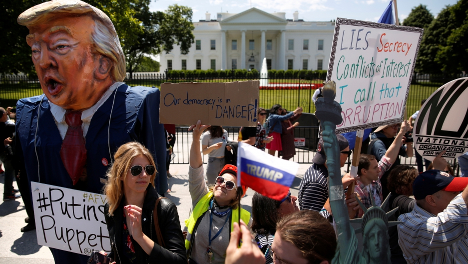 "Protesters outside the White House, May 10th 2017. One sign says ""Our democracy is in danger."""